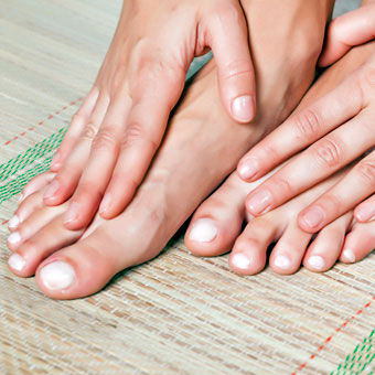 Photo of a woman's healthy toenails.