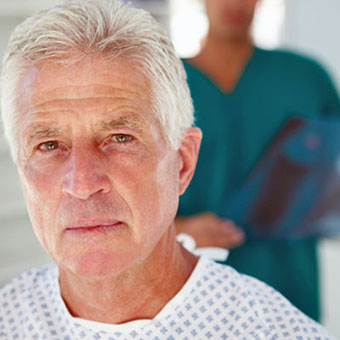 A senior male patient and doctor.