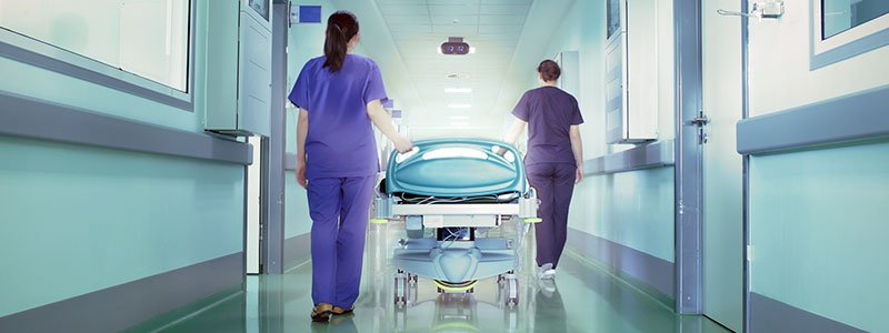 Medical team rushing to save a life.