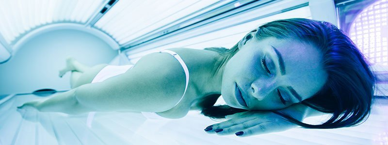 A man in a tanning salon bed.