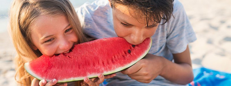 A boy eating watermelon.