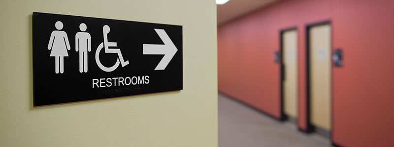 Female and male restroom sign.