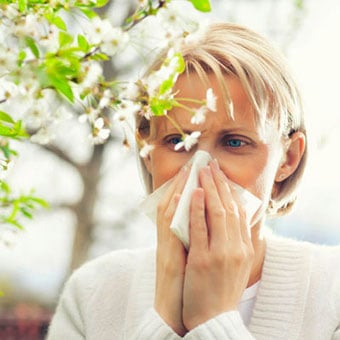A woman suffers from allergic rhinitis (hay fever).