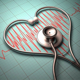 A stethoscope in the shape of a heart on a heartbeat pulse graph.