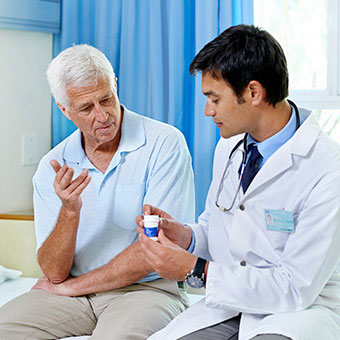 A doctor discussing medication and treatment options with a patient.