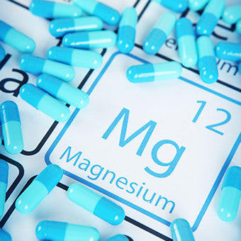 Magnesium supplements on a periodic table with Mg symbol.