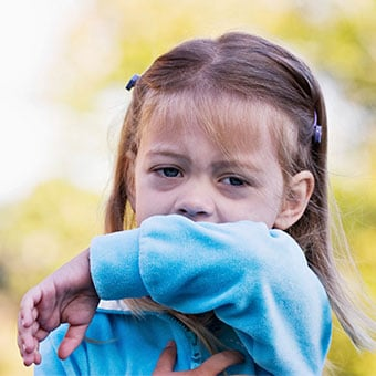Alt TextChildren are susceptible to croup and show signs of a chronic cough as well as fever and trouble breathing.
