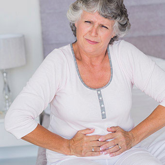 A woman experiencing abdominal pain.