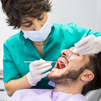 A dentist can diagnose dry sockets based on a physical exam and symptoms.