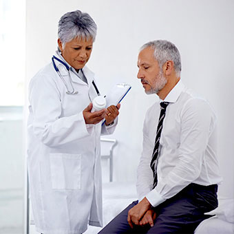 A doctor and patient discuss <i>H. pylori</i> treatment.