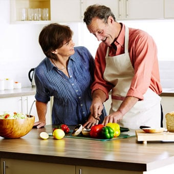 A couple preparing a healthy meal together.