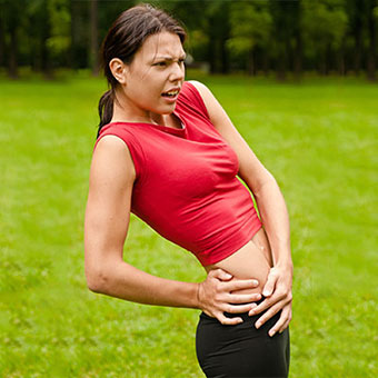 A woman experiences hip pain caused by bursitis.
