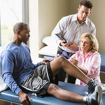 Medical professionals evaluate the need for knee replacements.