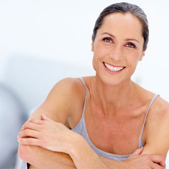 A mature woman in an exercise studio.
