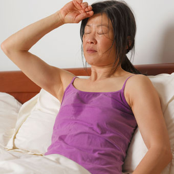 A woman experiencing night sweats.