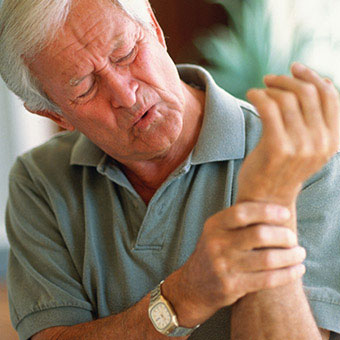 A man experiences rheumatoid arthritis (RA) joint pain in his wrist.