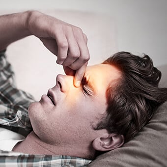 Sinus headache symptoms include excess mucus, swelling and pain in the sinuses.