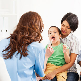 A child is evaluated to see if a tonsillectomy or adenoidectomy surgery is needed.