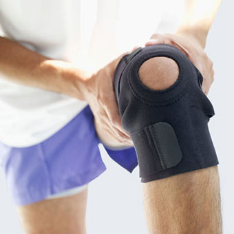A man wears a knee brace.