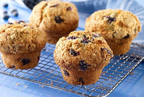 Photo of blueberry muffins on a cooling rack.