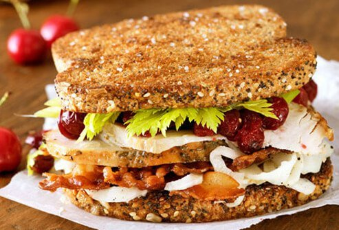 Photo of turkey sandwich with cranberries.
