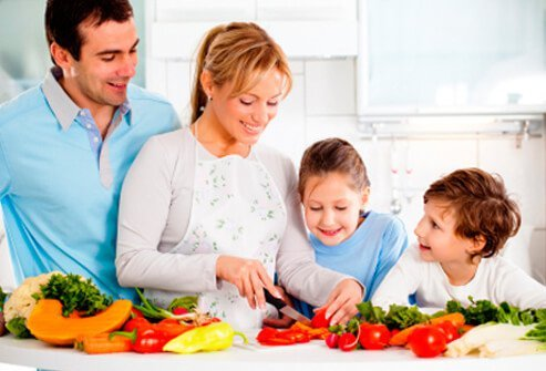 A family cooks a nutritious meal.