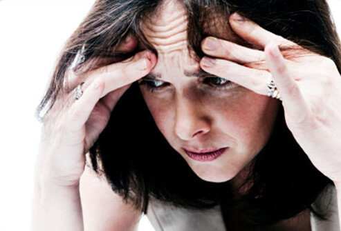A woman experiences anxiety, a symptom of heart disease.