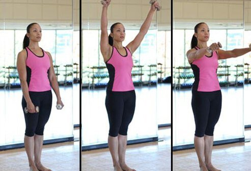 A pair of small hand-weights adds punch to a Pilates workout at home.