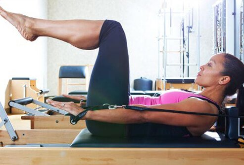 In a studio, you can try the Pilates hundred on a reformer, a spring-based resistance machine.