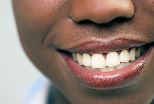 The simple act of smiling may help you feel more positive.