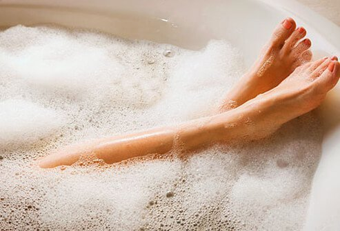 Photo of woman relaxing in bath.