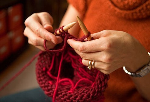 Photo of woman exercising brain with crochet.