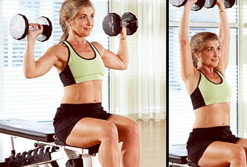 A shoulder press works the shoulder muscles and can be performed standing or seated.
