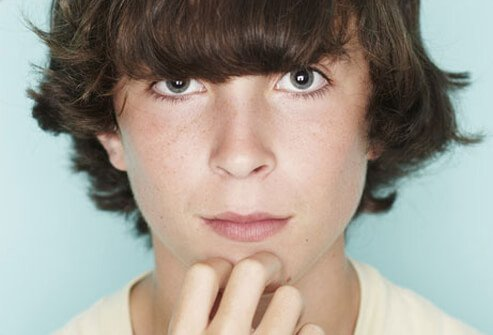 Touching your face may trigger acne.