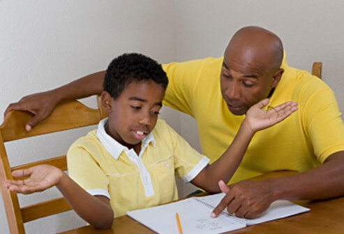 A father tries to help his son who doesn't understand and is giving up on homework.