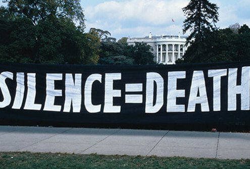 ACT UP activists protest US AIDS policy with Silence=Death motto.