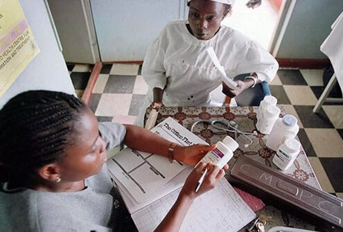 A woman receives medicine in a Nigerian AIDS clinic.
