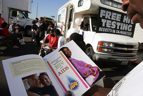 L.A. man reads an AIDS brochure as he waits for his HIV test results.