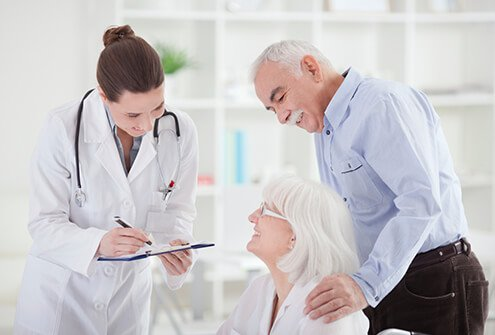 A doctor in discussion with a patient with Alzheimer's disease.