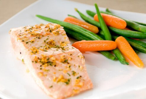 When you have insomnia, an example of foods that help you sleep can be a light dinner of salmon and steamed veggies.