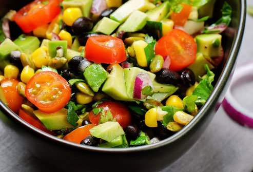 Get all the flavor of a taco salad without the extra calories by topping it with black beans and avocado.
