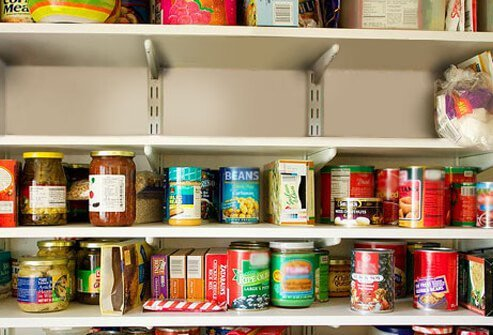 A cupboard full of food.