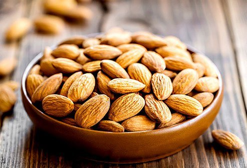 Eat antioxidant-rich foods to clear acne like nuts.