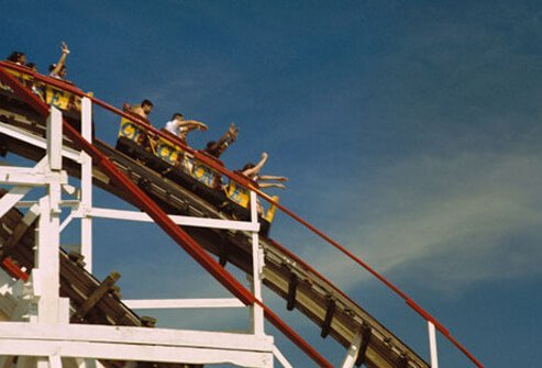 People on a rollercoaster at an amusement park.