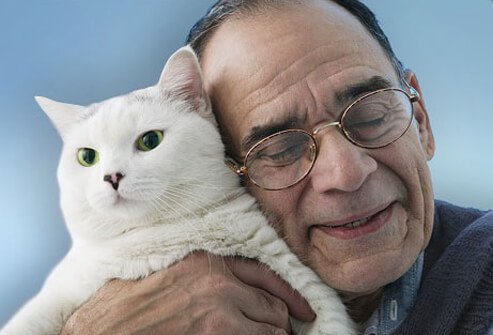 Photo of an older man with his cat.