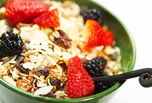 A bowl of whole grain cereal with berries.