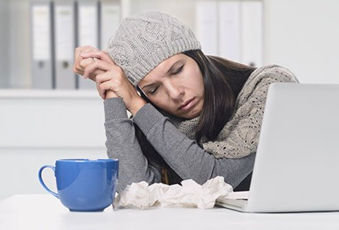 A woman suffering from the symptoms of the flu.