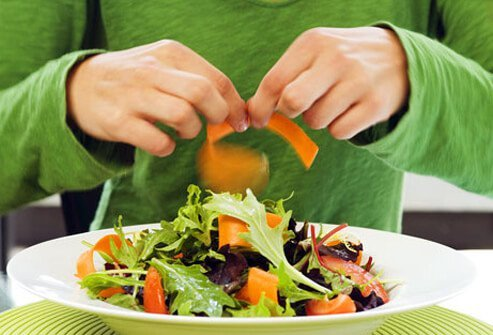 A person making a salad.