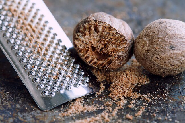 Large amounts of nutmeg may make you sick from myristicin in the spice.