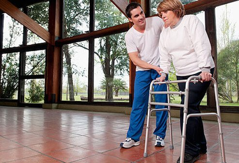 Photo of physical therapist working with patient.